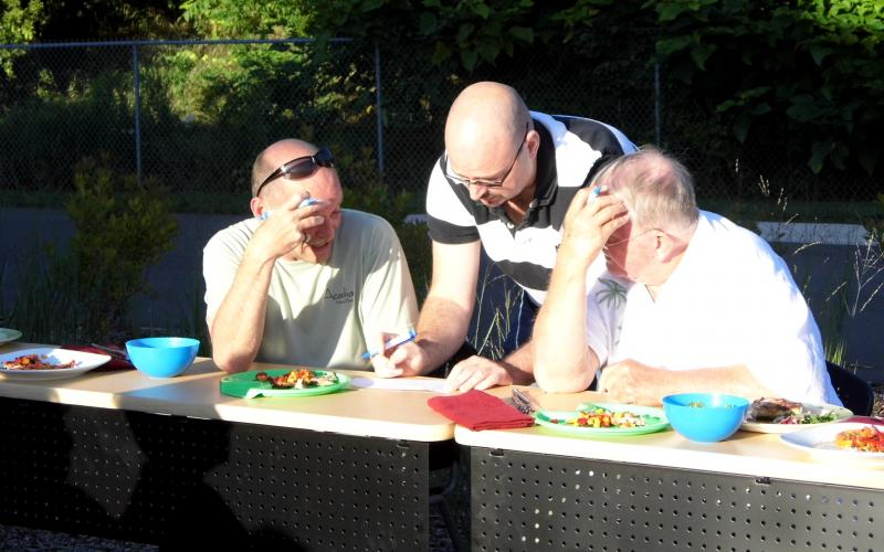 The judges deliberate over the dishes and the scores.